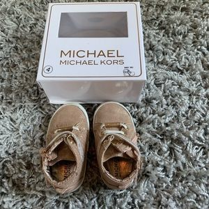 Michael Kors rose gold high tops